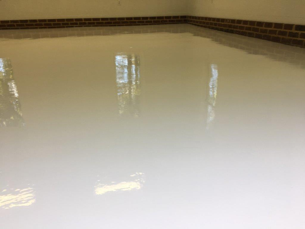 A Pure White Epoxy Floor With Polyurethane Top Coat Adds Cl And Elegance To This Garage